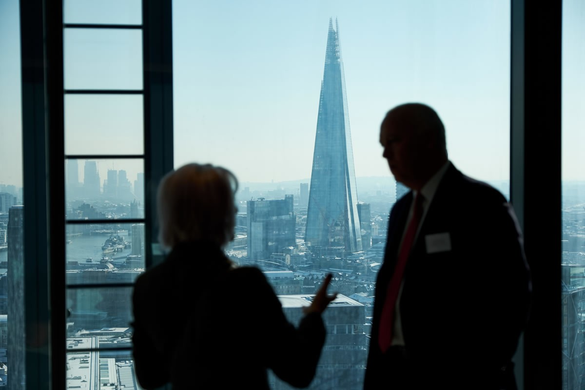 two people talking at the Build UK Open Doors Launch with the Shard in the background