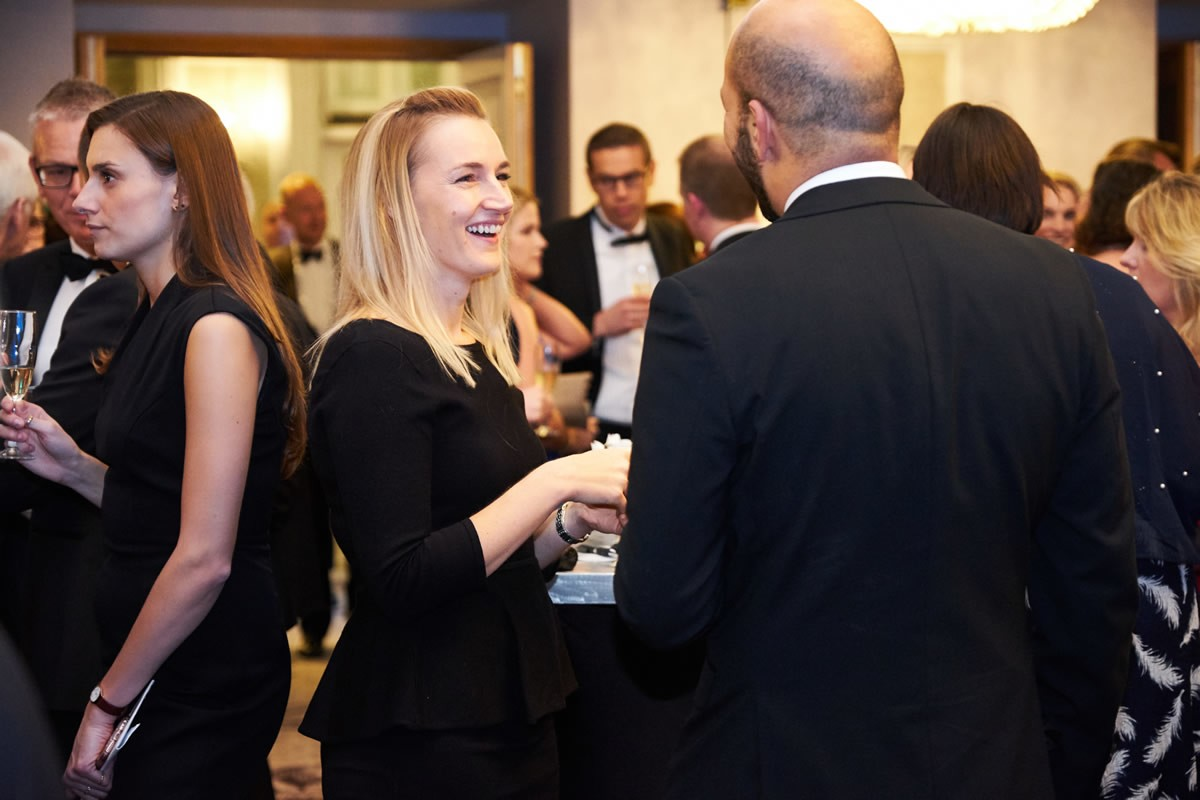 guests talking to each other at the reception for the Law Society Awards