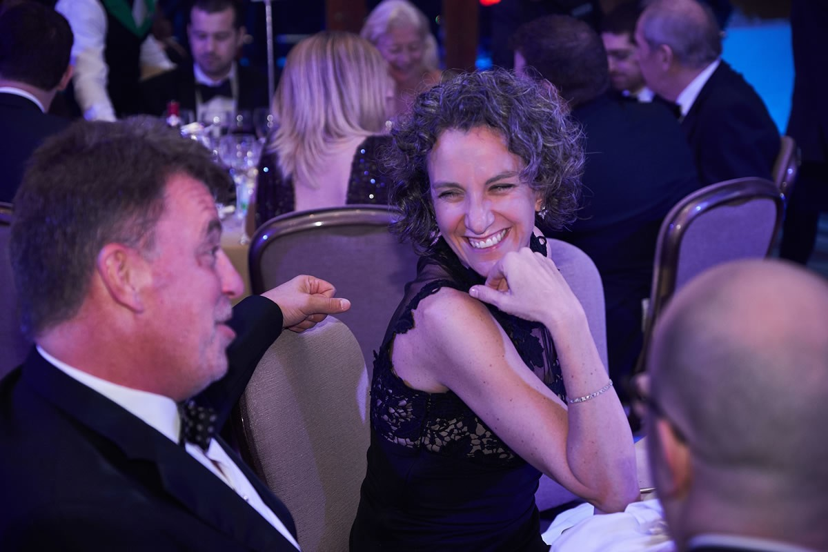 a guest laughing at a joke at the Law Society Awards