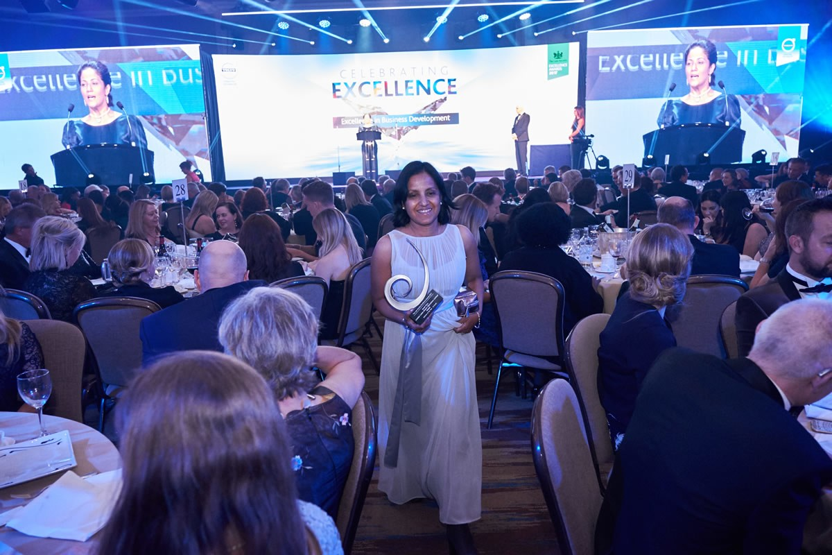 a guest walking back to her table after receiving an award at the Law Society Awards