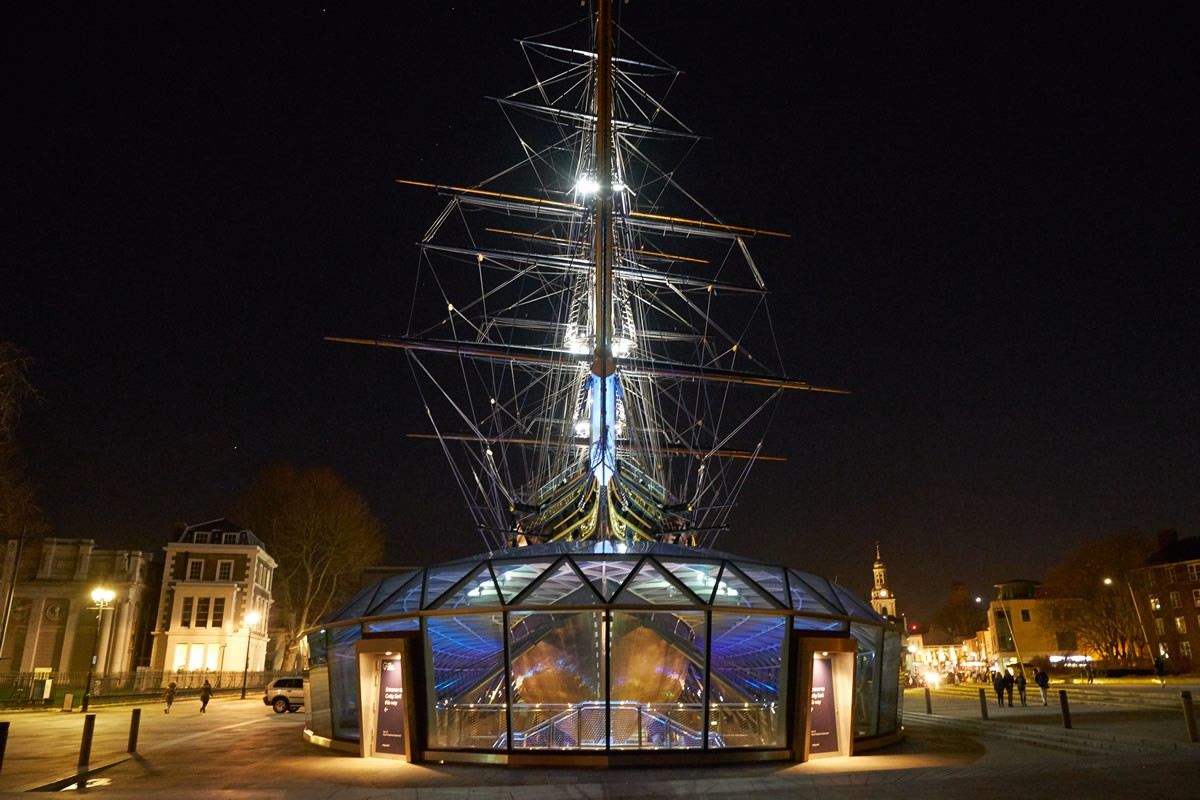 The exterior of the Cutty Sark at night