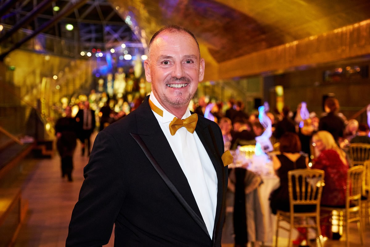 a corporate portrait of a guest at a Cutty Sark event