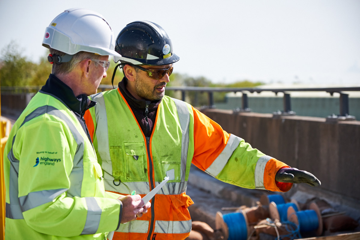a foreman and a worker discussing the work