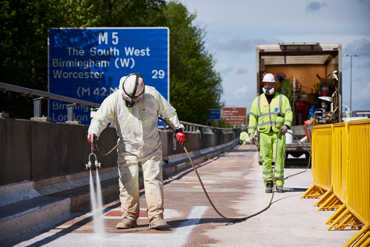 a worker spraying a motorway