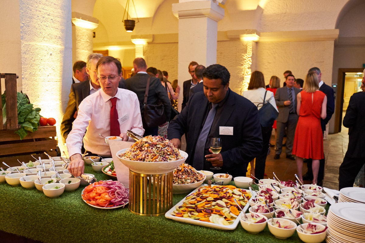 attendees choosing food at an event