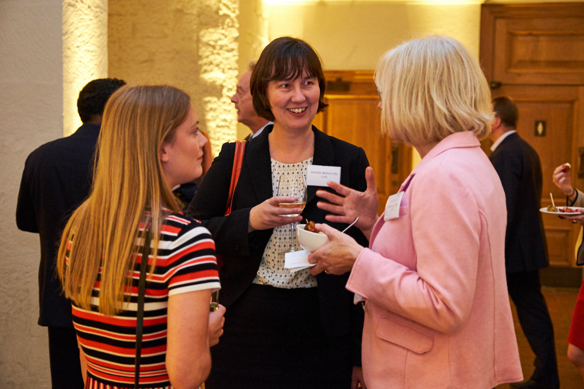 business women talking at a London event