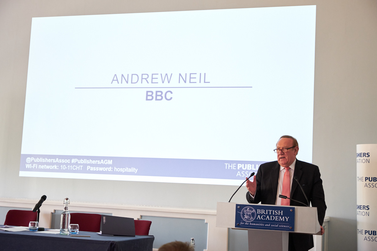 Andrew Neil talking at a London event