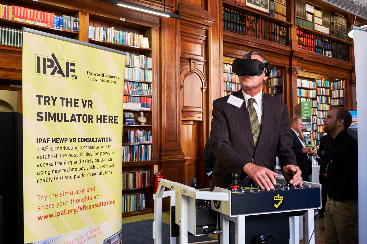 a guest at a London event using a virtual reality machine while being photographed for Commercial Photography London