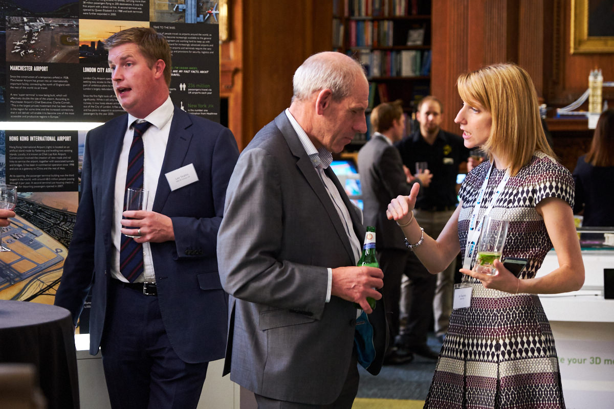a Build UK employee talking to a guest at a London event