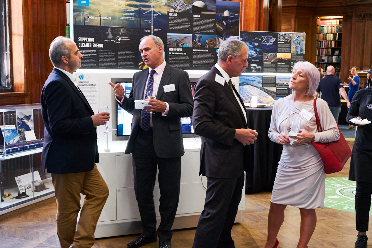 guests discussing new technology in the building industry