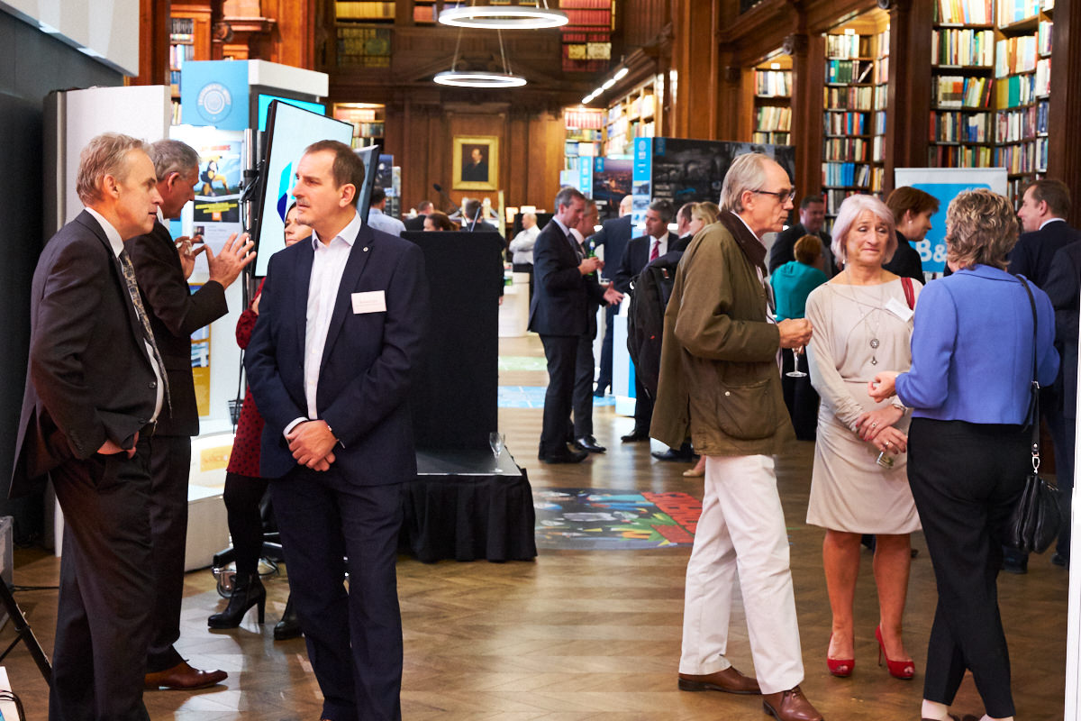 guests at a London event in the library at One Great George Street
