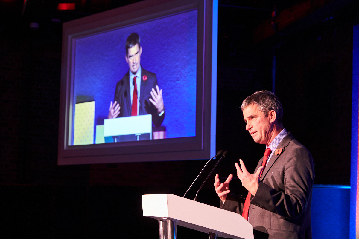 A guest speaker talking at a podium at an event at The Brewery in London, photographed by a London event photographer