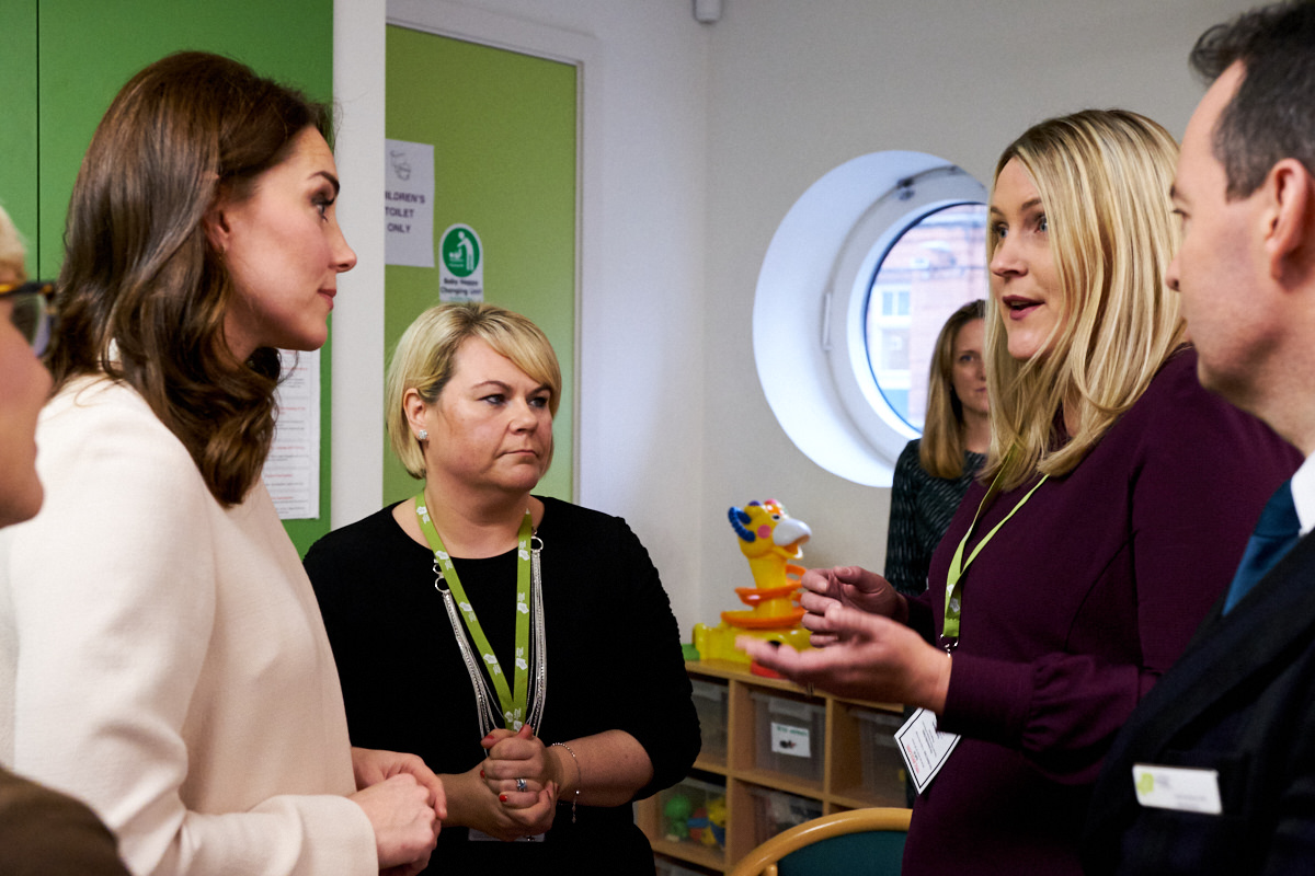 The Duchess of Cambridge discussing the running of the Hornsey Road Children's Centre with staff