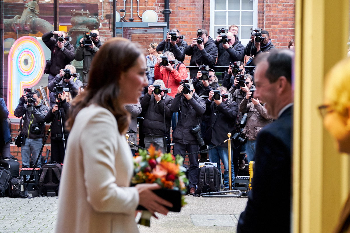 The Duchess of Cambridge with press photographers in the background