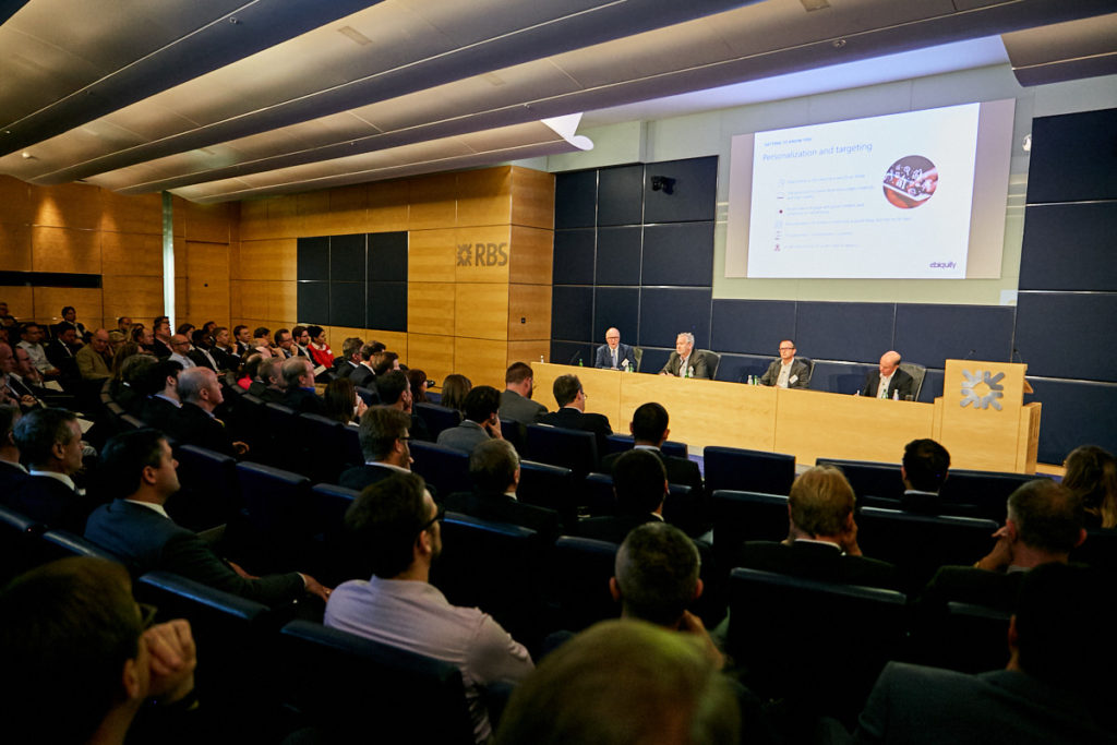 a panel of speakers at a conference