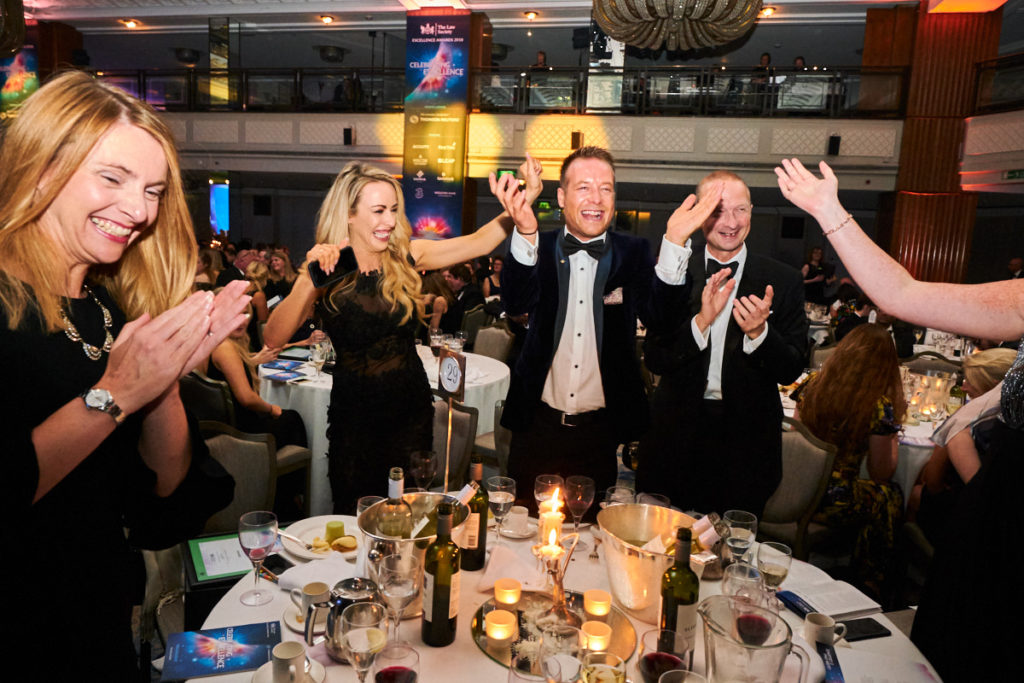 Guests at an award ceremony in London reacting to winning an award