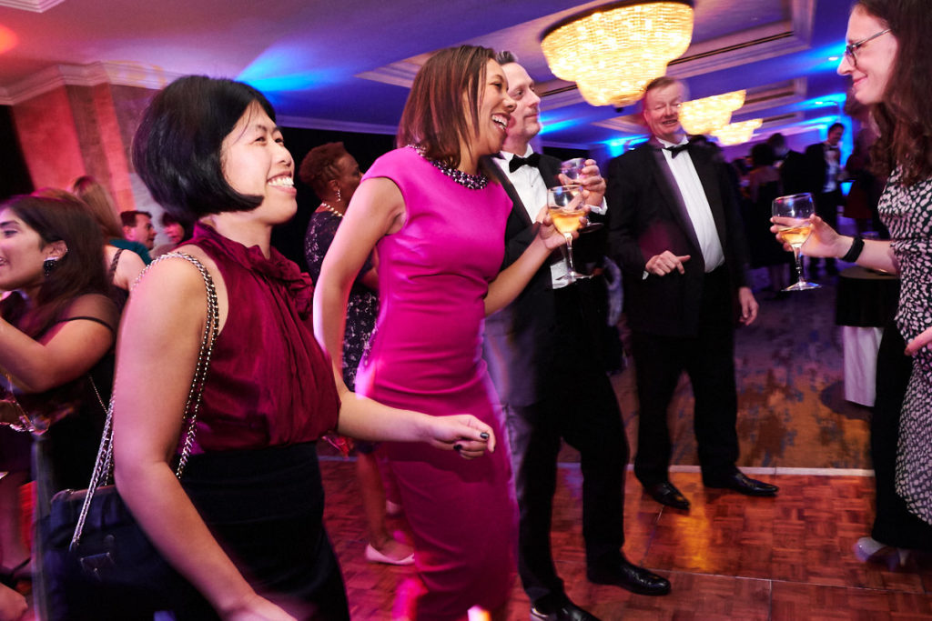 Guests at an event dancing