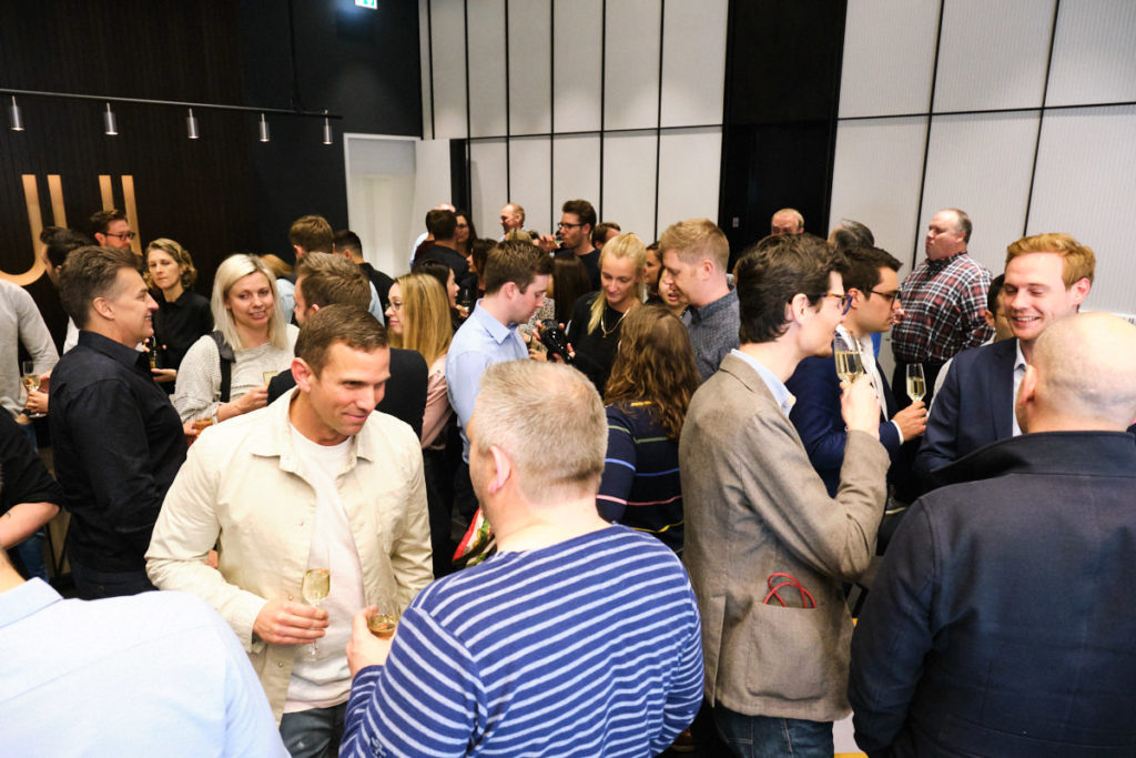 guests drinking and talking at an event in London offices
