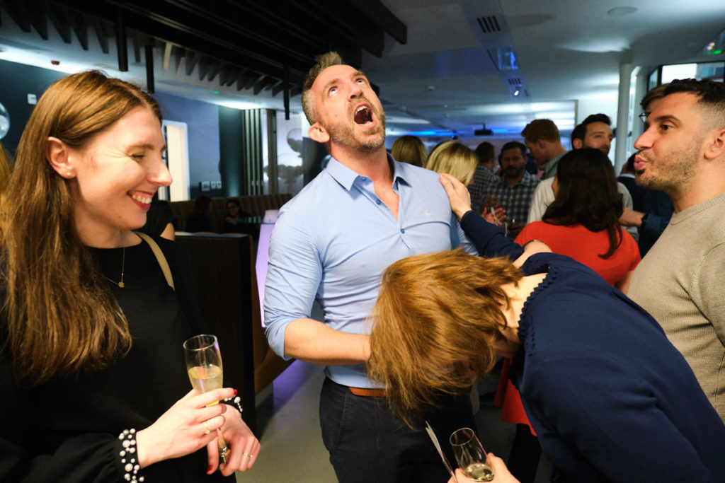 guests laughing at this London event