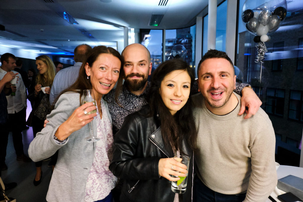 guests posing for a photo at a London party