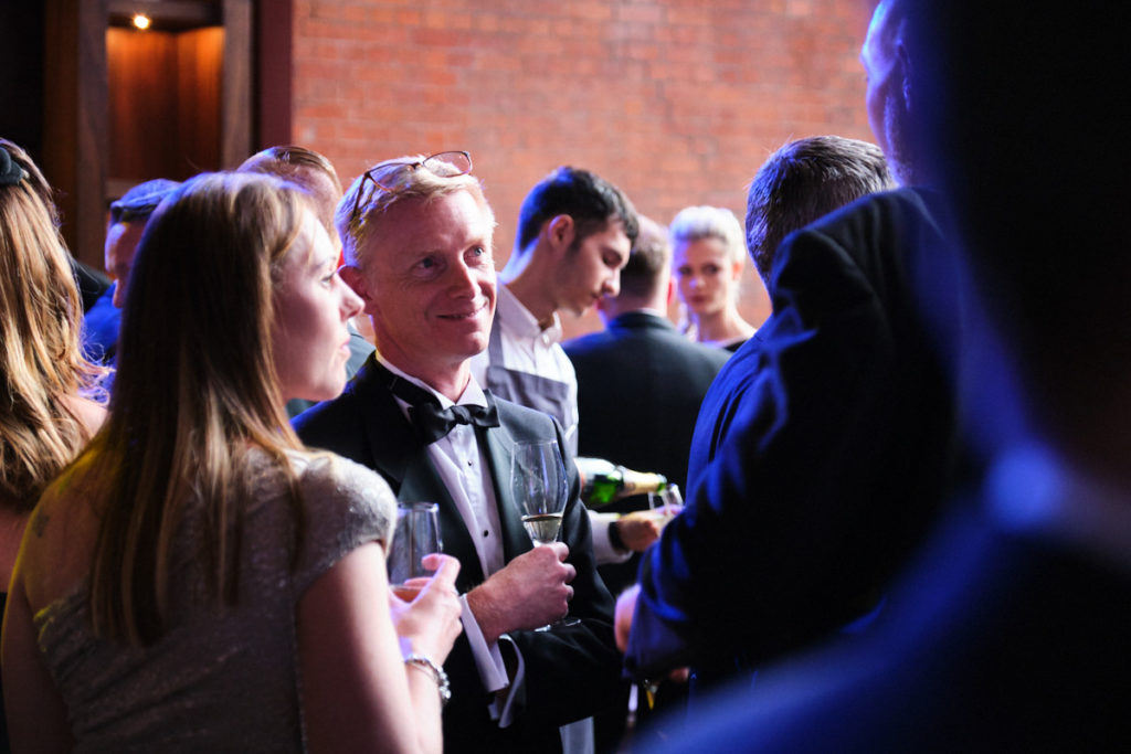 guests at a London event talking to each other
