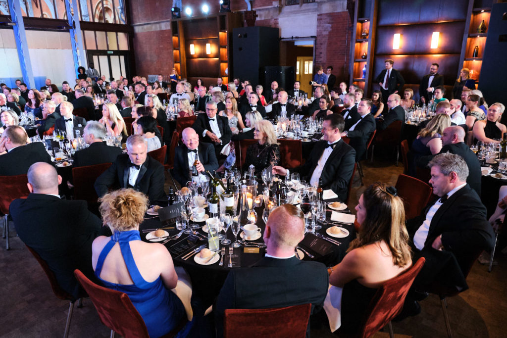 guests seated for dinner at an event in London