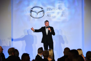 the master of ceremonies on stage at an event in London
