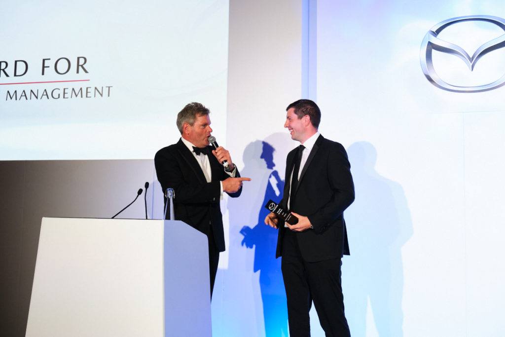 a guest receiving an award at an event in London