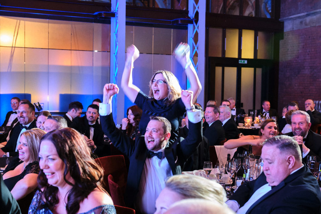 guests cheering when their team win an award