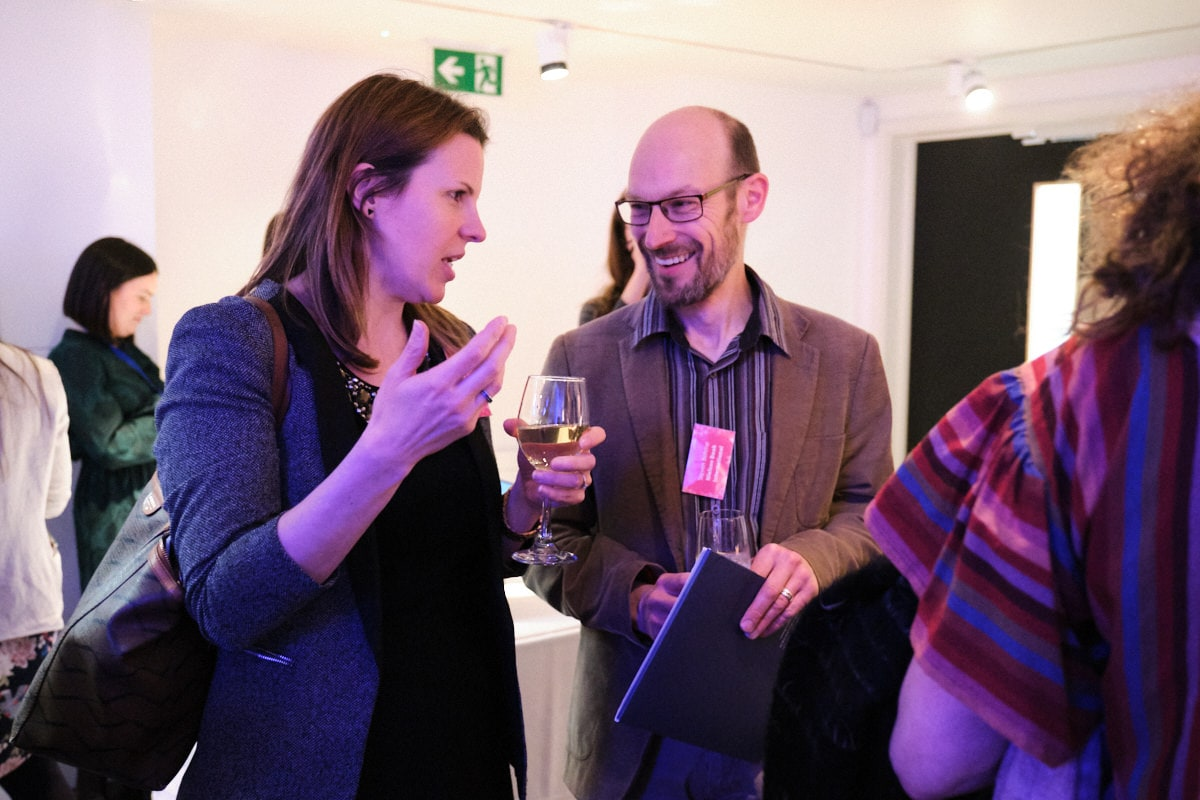delegates discussing publishing at a London event