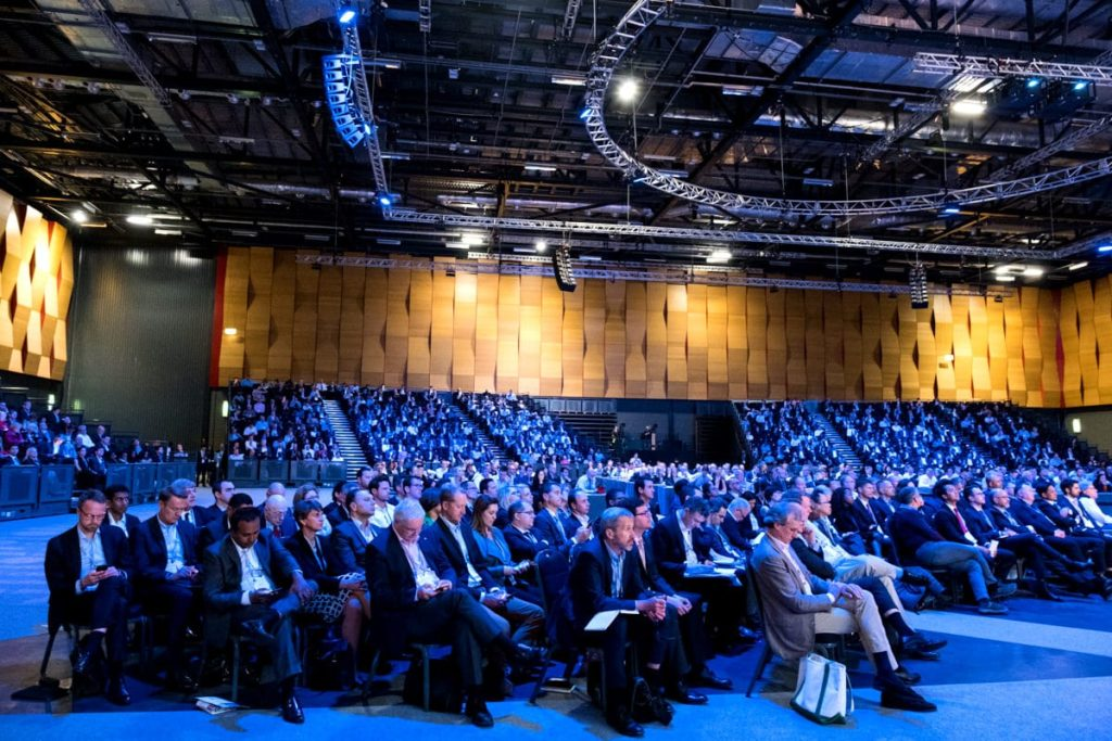 delegates listening to a speaker at a conference at ExCeL London