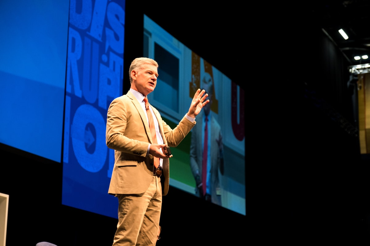 A speaker talking at a conference in London