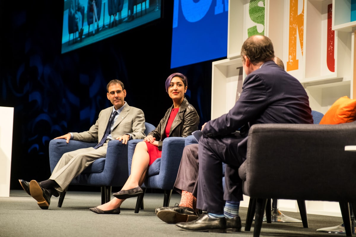 Speakers at a conference at ExCeL London debating on stage